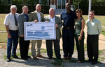 08-17-2006 Check for $295,200 Helps Begin Residential Youth Offender Facility in Nash by Southwestern Oklahoma State University