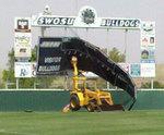 04-18-2011 High Winds Force SWOSU Baseball Fans to Keep Score the Old Fashion Way 1/2 by Southwestern Oklahoma State University
