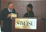 Yolanda Carr Presents Certificate of Appreciation Plaque to Ken Rose