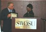 Yolanda Carr Presents Certificate of Appreciation Plaque to Ken Rose